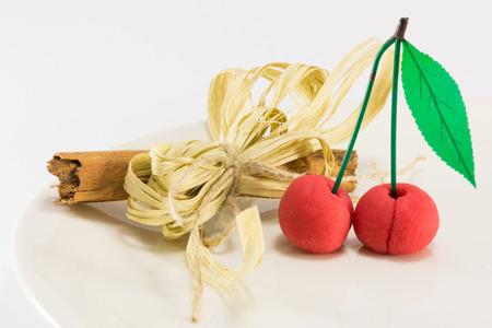 ingradient: sweet marzipan cherry fruit with cinnamon spicy stick, candies dessert