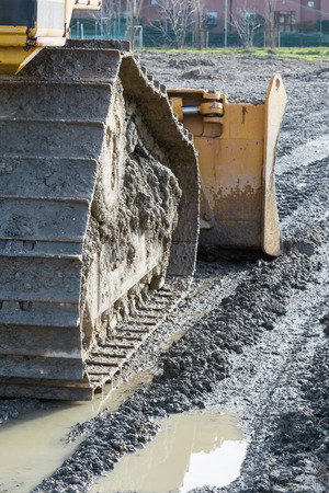 tracked: closeup of tracked loader excavator at stony quarry on a building site