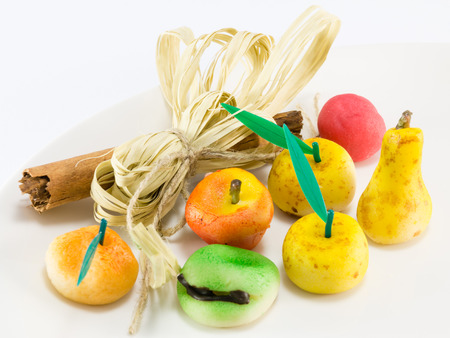 sugar paste: Colorful sweet marzipan fruits with cinnamon spicy stick decoration, candies dessert