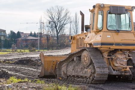 tracked: tracked loader excavator at stony quarry on a building site