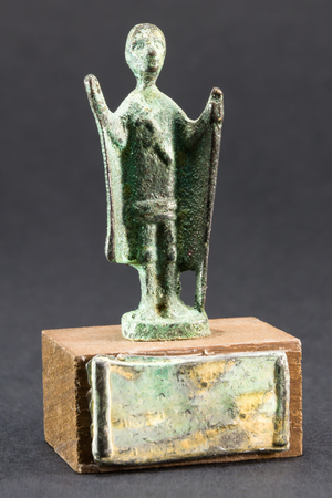 chieftain: Chieftain praying with cloak and stick, bronze figurine