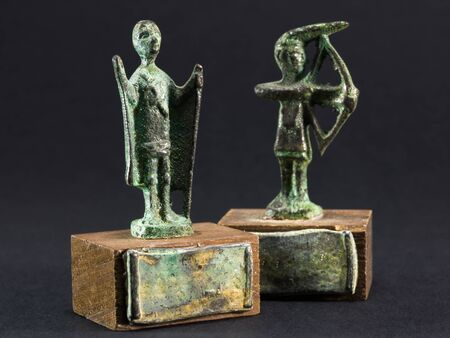 chieftain: archer bronze statuette and chieftain praying with cloak and stick fgurine Stock Photo