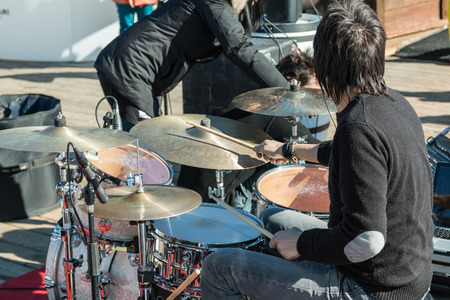percussionist: black hair drummer during outdoor concert
