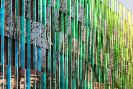 Public Office building with colorful graduated shading and reflexions in windows 스톡 콘텐츠