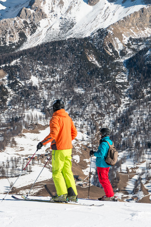 skiers: skiers with colorful clothes and helmet waiting for skiing Stock Photo