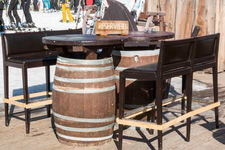 booked: Reserved barrel shaped table in mountain chalet Stock Photo