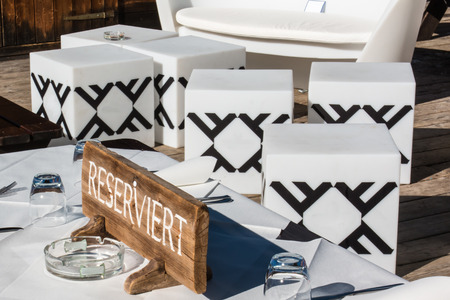 reserved seat: Reserved wooden furnished table in mountain chalet