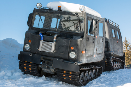 roadless: Articulated military tracked cargo vehicle with two units on snow