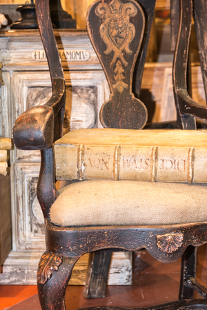 vintage chair: Old antique Latin book on vintage chair