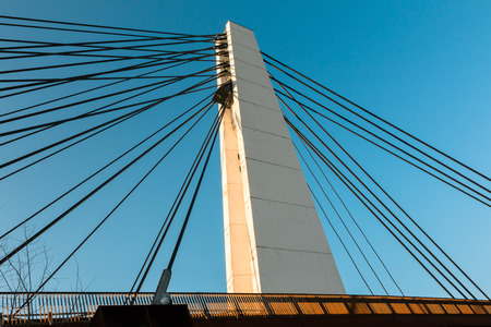 steel cable: White steel cable bridge in modern architecture style against blue sky