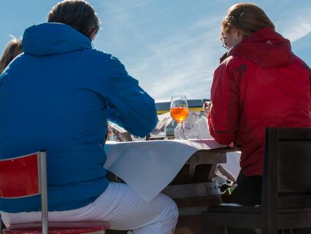 spritz: Spritz aperitif, orange cocktail on wooden table outdoor in mountain