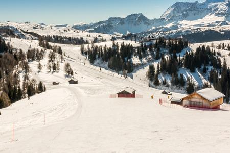 ski run: Sunny Ski Slope at ski resort in winter day