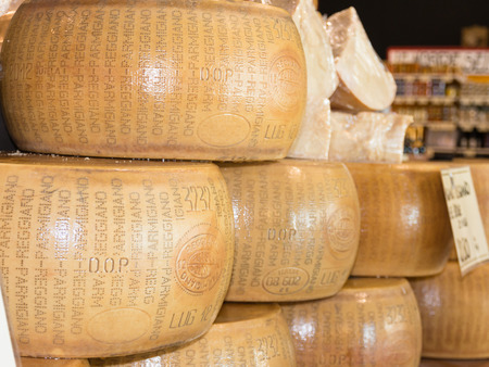 stacked circular blocks of Parmigiano Reggiano Italian cheese for sale