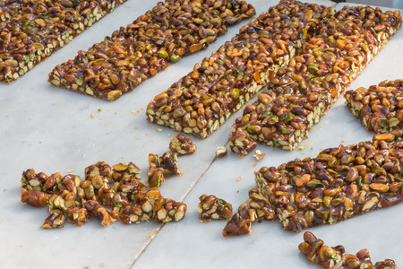 brittle: chunks of italian peanut brittle: caramel, almonds and hazelnuts Stock Photo
