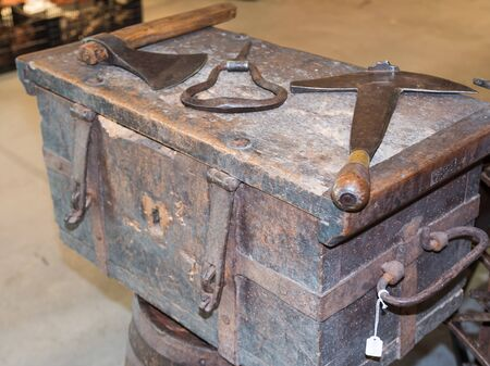 amputation: old rural rusty tools above antique wooden box Stock Photo