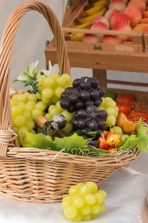 wick: fake white and red grapes in wicker basket: candles with wick grapes shaped