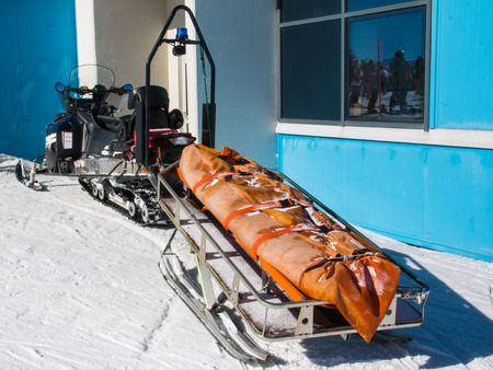 emergency stretcher: snowmobile with stretcher used by emergency services in ski area