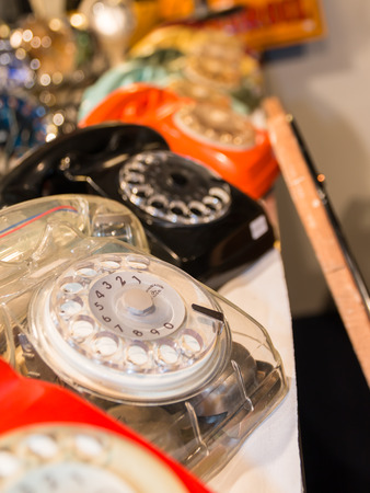telephones: vintage colorful and aligned telephones with handset