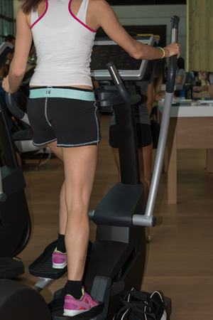 crosstrainer: Closeup of Fitness Girl with Shorts Exercising on Stepper, Crosstrainer