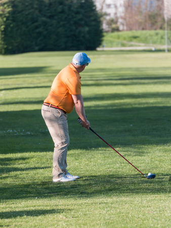golf cap: Fat Man with Blue Cap and Orange Polo Shirt playng Golf, Golfer