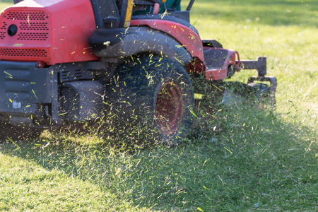 Riding Lawn Equipment with operator for periodically garden upkeep