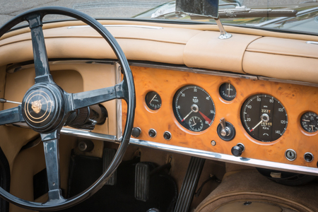 drivers seat: PARMA, ITALY - APRIL 2015: Retro Vintage Jaguar Car drivers seat and dashboard