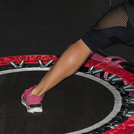 Woman's Leg Close-up: Fitness on Mini Trampoline