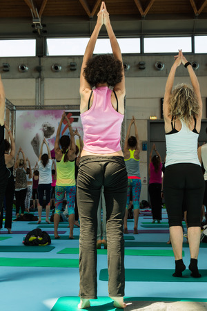Women in Sport Clothes doing Mountain Pose in Yoga Class