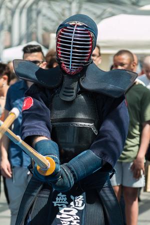 swordsmanship: Kendo Warrior with Kendo Uniform and Bamboo Sword. Japanese Martial Art Editorial