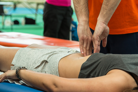relaxation massage: athlete belly relaxation massage during fitness activity, wellness and sport