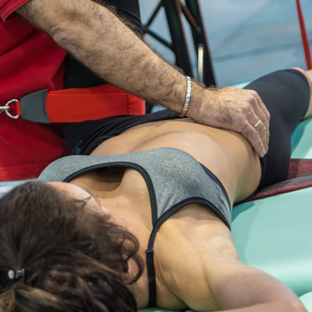 Closeup of Girl doing Fitness Traction Therapy on Bed with Suspension-based Exercise Training System