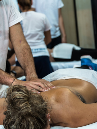 adjustment: Chiropractor doing Manual Adjustment on Athletic GirlSpine after Sport Activity