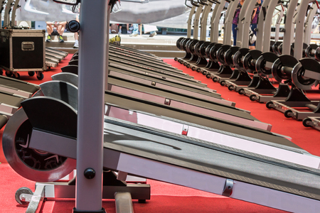Group of Modern Treadmill with Steel Wheels in Line in Fitness Centre