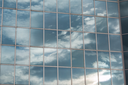 reflected: Blue Sky and Clouds Reflected in the Glass Building