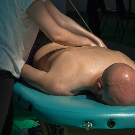 spinal adjustment: Chiropractor doing Manual Adjustment on Athletic GirlSpine after Sport Activity