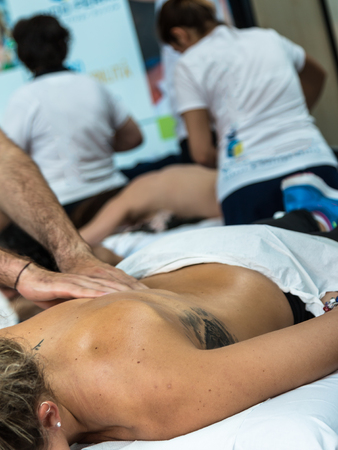 spinal manipulation: Chiropractor doing Manual Adjustment on Athletic GirlSpine after Sport Activity