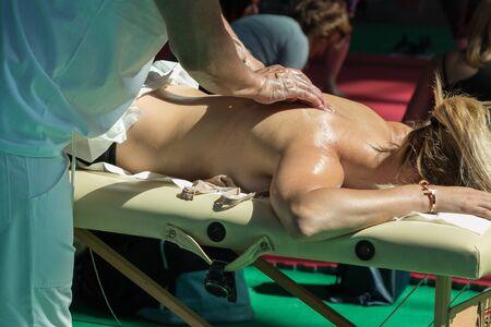 spinal adjustment: Chiropractor doing Manual Adjustment on Womans Shoulder after Sport Activity
