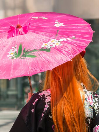 red hair girl: Red Hair Girl with Traditional Japanese Pink Wagasa Umbrella