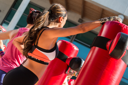 boxing tape: Young Girl in Fitness Sportswear and Punching Bags, Female Kickboxing Exercise in Outdoor Gym