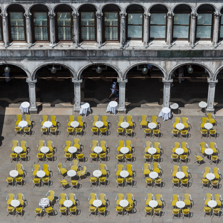 saint marks square: Red and Yellow Chairs and Round Tables Aerial View on Famous Saint Marks Square in Venice, Italy