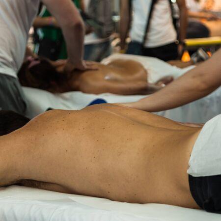 spinal adjustment: Chiropractor doing Manual Adjustment on Athletic ManShoulder after Sport Activity Stock Photo