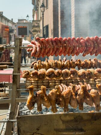 sizzle: Outdoor Vertical Grilled Meat with Chicken, Pork and sausages
