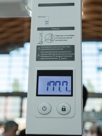 human height: Digital Display Output of Human Height in Modern Stadiometer Stock Photo