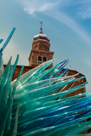 san giacomo: Detail of Blue Murano Glass Sculpture in Murano with San Giacomo Church in Background, Venice - Italy Stock Photo