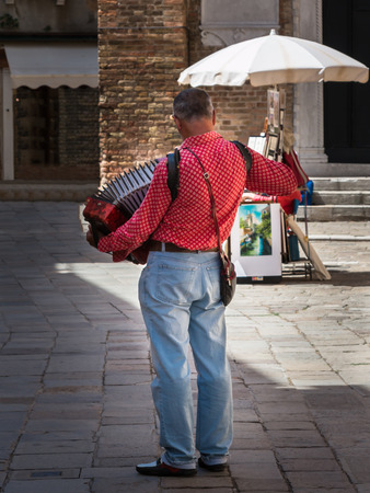 entertainer: Street Musician Entertainer with Red Accordion