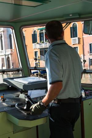 steamboat: Venice Urban Steamboat Driver in Cabin, Italy