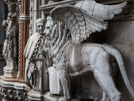 winged lion: Particular of Doges Palace Facade in Venice: Marble Winged Lion