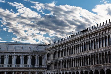 Napoleonic Wing and Procuratie Vecchies arcades in Saint Marks Square in Venice, Italy Stock Photo