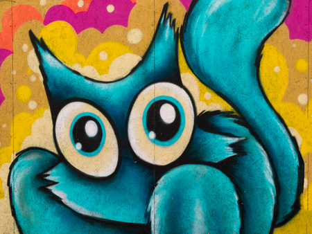 type writer: Funny Blue Cat Grafito on Public Wall, Street Art Graffiti Stock Photo