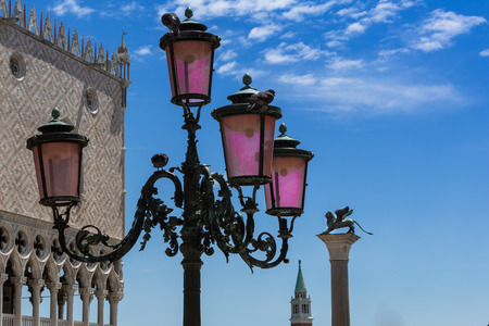 leon alado: Typical lamp, Doges , San Giorgio Maggiore Bell Tower and Winged Lion Column in Venice - Italy Foto de archivo